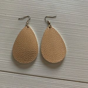 Rose Gold faux leather earrings.